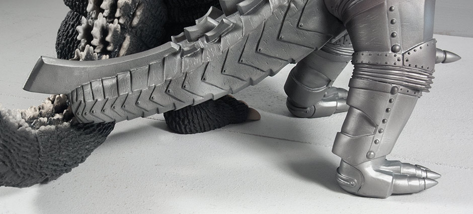 Mechagodzilla's tail can lean on its nearest neighbor negating the need for the base.