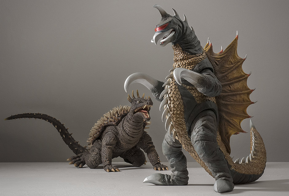 X-Plus Gigan watches Godzilla get lasered off screen as Anguirus sneaks up for an attack.