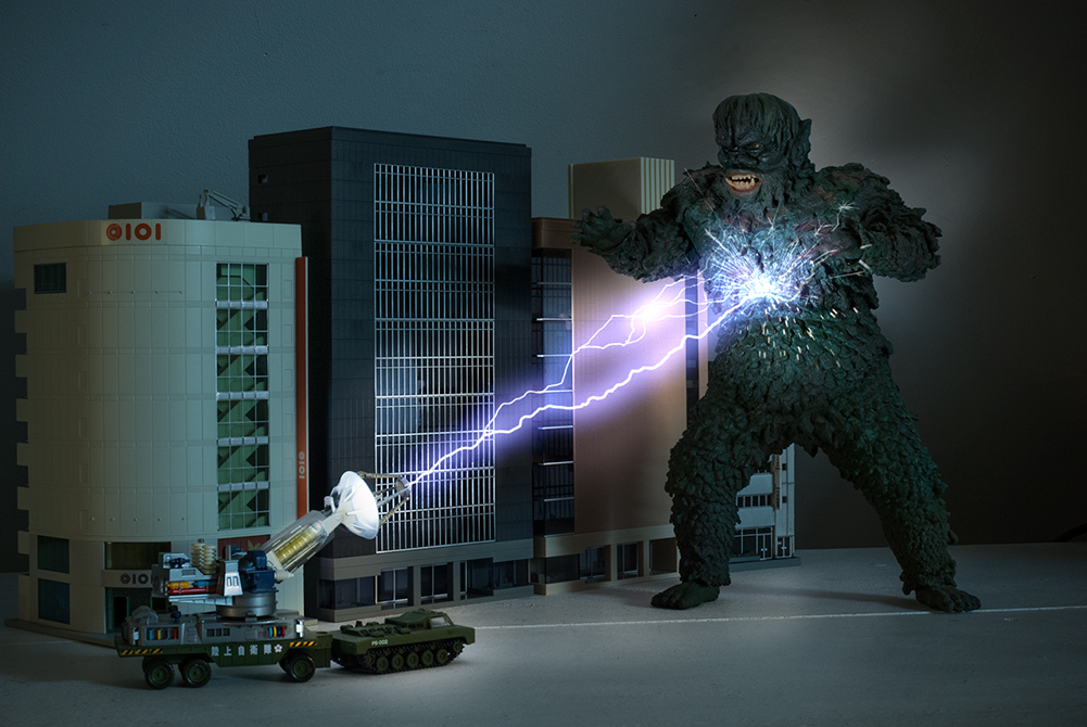 Photoshopped image of X-Plus Gaira vinyl with Revoltech Maser cannon and n scale buildings.