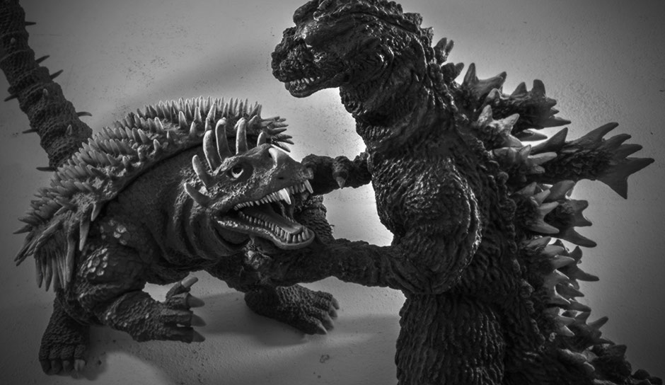 X-Plus Godzilla and Anguirus 1955 vinyl figures posed to fight.
