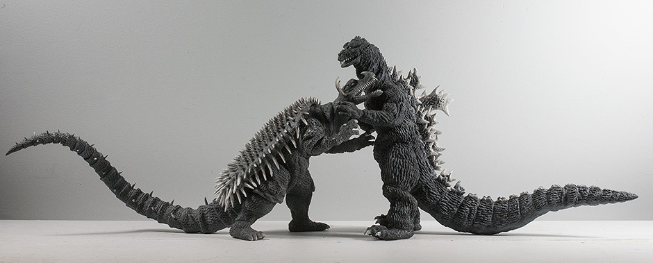 The X-Plus Godzilla and Anguirus 1955 vinyl figures interlocked into a fighting pose.