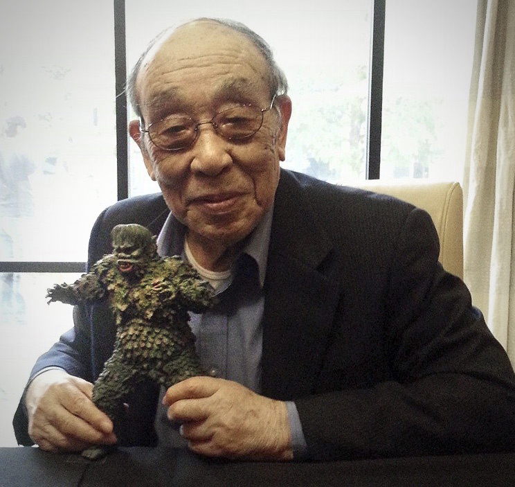Godzilla suit actor Haruo Nakajima with the X-Plus Gaira vinyl figure.