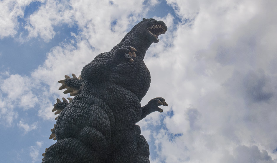 Worm's-eye-view of the X-Plus 30cm Godzilla against the sky.