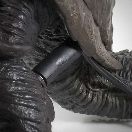 Close-up of battery pack plug with leg in retracted position.