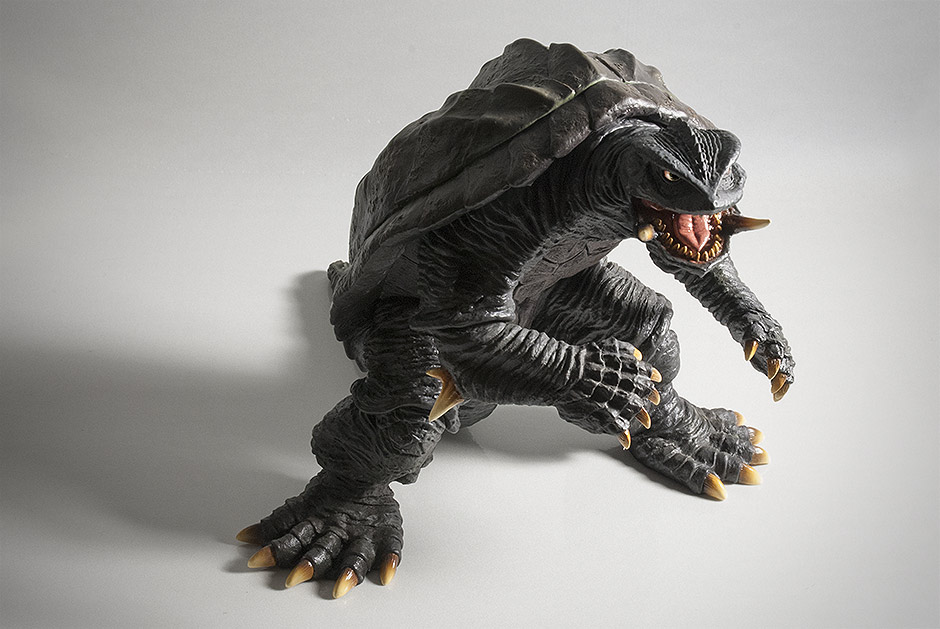 Dynamic angle of Gamera figure on white background.