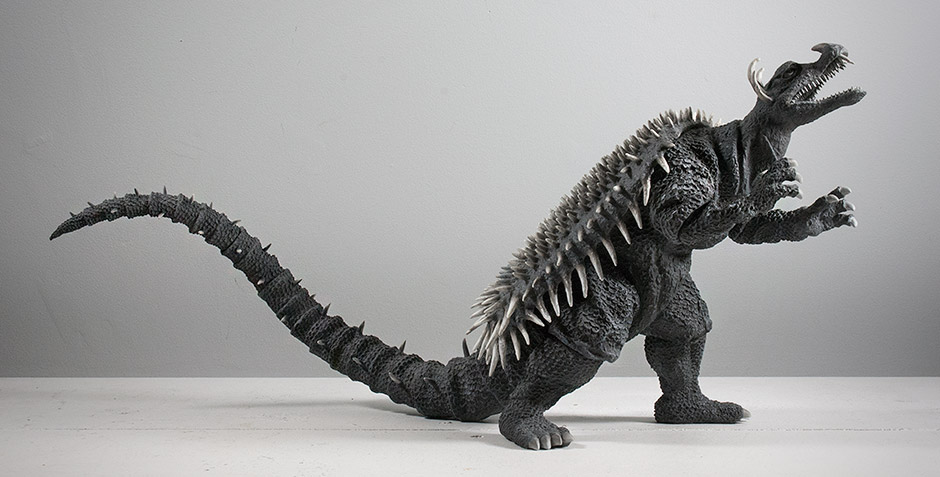 Anguirus' tail should curve downward.