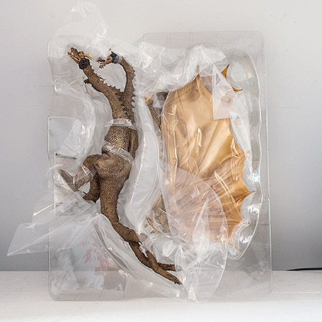 Interior packaging for the X-Plus King Ghidorah 1968 vinyl figure.