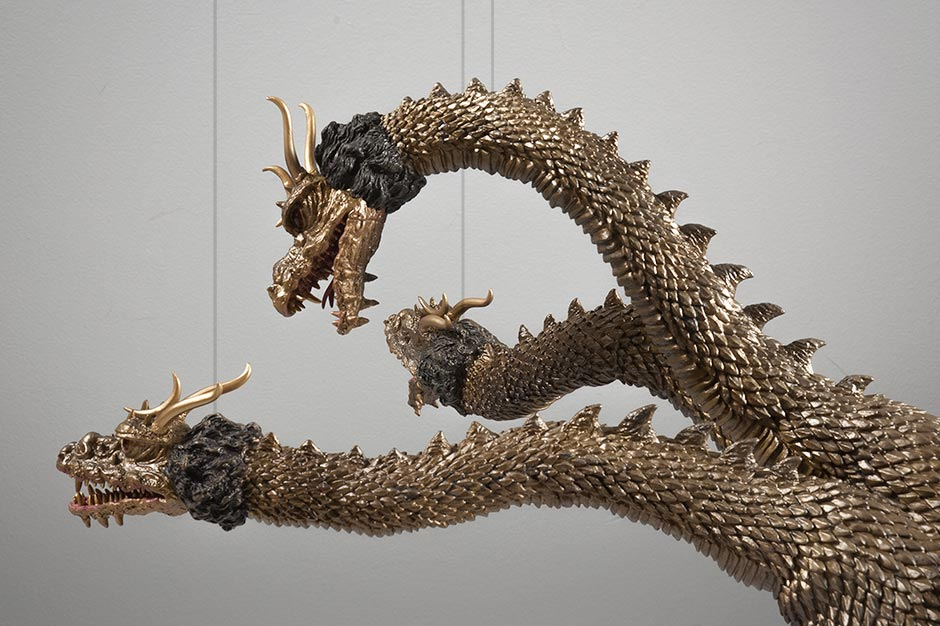King Ghidorah's heads sculpted to mimic strings from the movie.