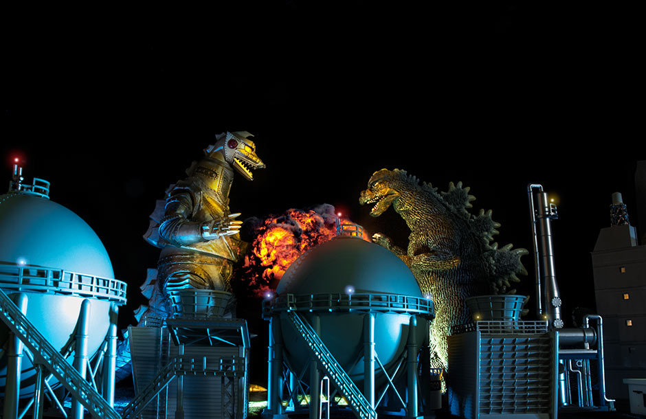 Godzilla fight composite with TomyTec refinery structures.