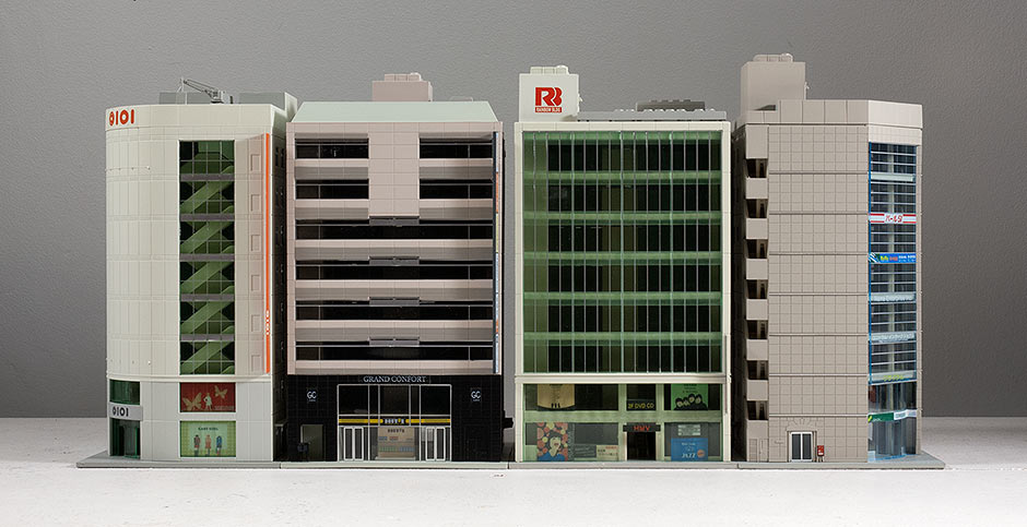 Four N Scale Kato Buildings, front view.
