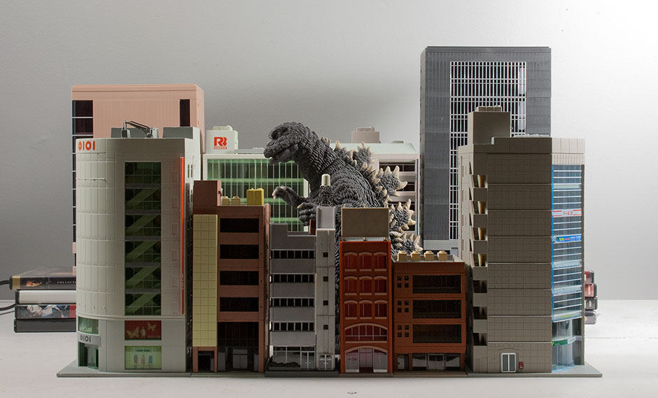 Large Monster Series Godzilla 1968 vinyl figure with N-Scale buildings.