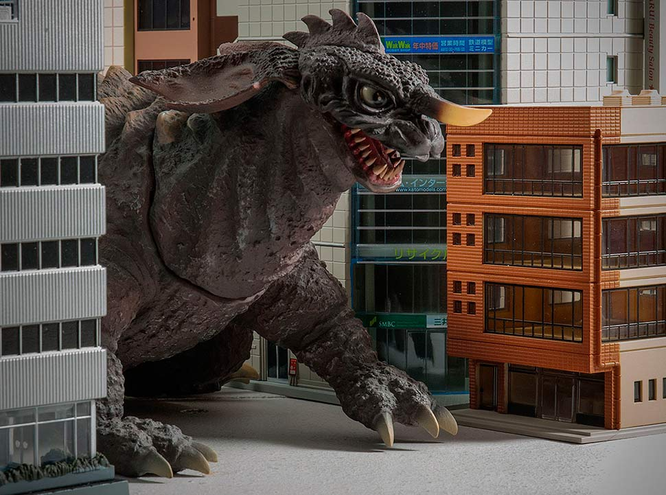 X-Plus Crawling Baragon vinyl with N-Scale buildings.