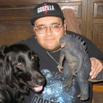 A photo of the Butch Bollinger and his X-Plus Godzilla 2014... and his dog Godzilla.