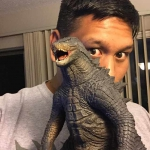 Joshua Habito with his X-Plus Godzilla 2014 Vinyl Figure.