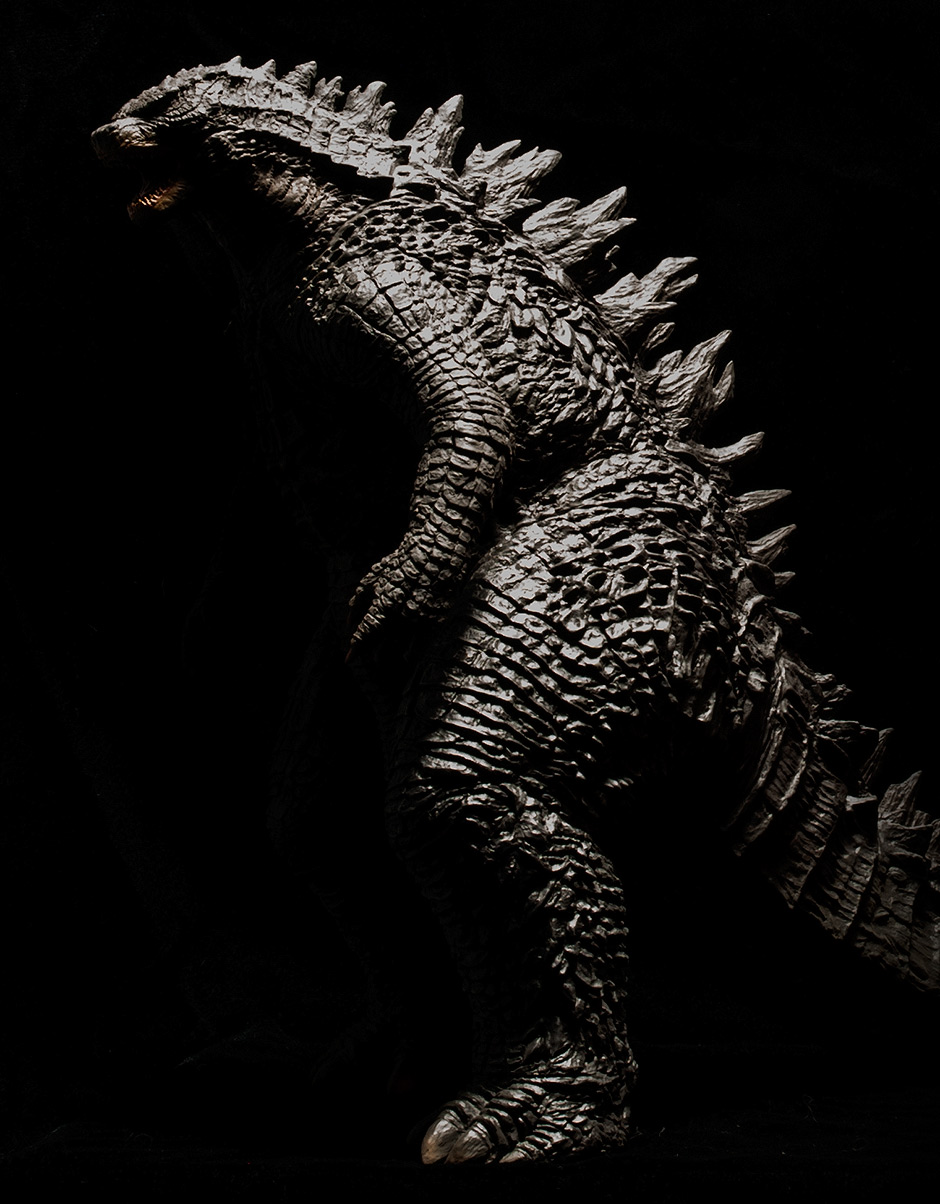 Stylized dark photo of Godzilla 2014 profile.