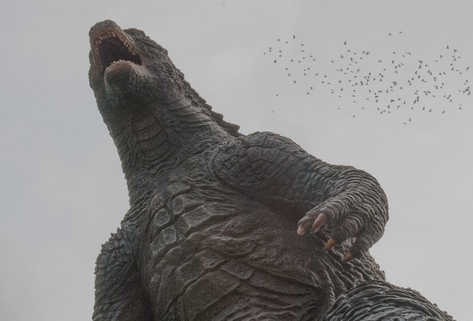 Low angle sky shot of the X-Plus Godzilla 2014 with birds.