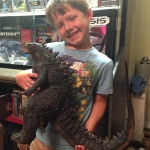 Tanner with Uncle Ryan Bullard's X-Plus Godzilla 2014.