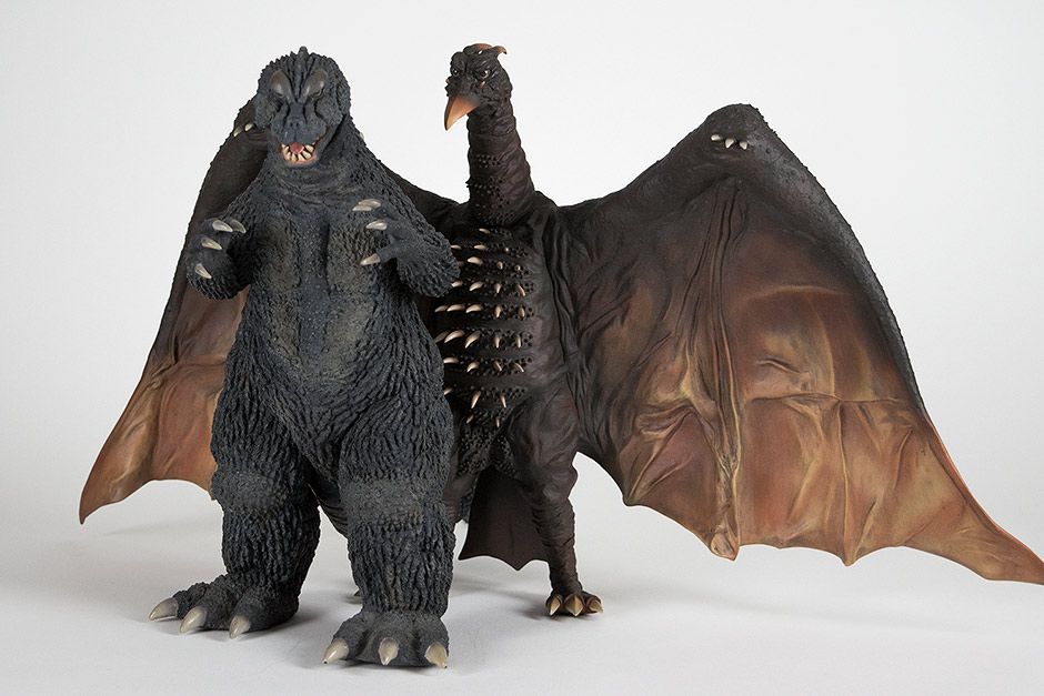 Rodan's wing can fit snugly over Godzilla 1964's tail and lean on it for support.