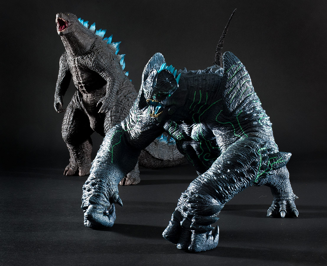 The 30cm Series Godzilla 2014 (Roaring Version) and the Large Monster Series Pacific Rim Leatherback vinyl figures by X-Plus.