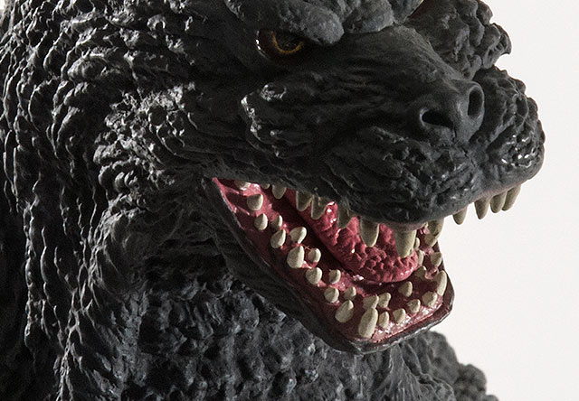 Close-up of the mouth detail on the X-Plus Godzilla 1992 vinyl figure.