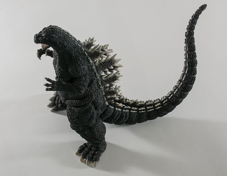 High angle side view of X-Plus Godzilla 1992 vinyl figure.