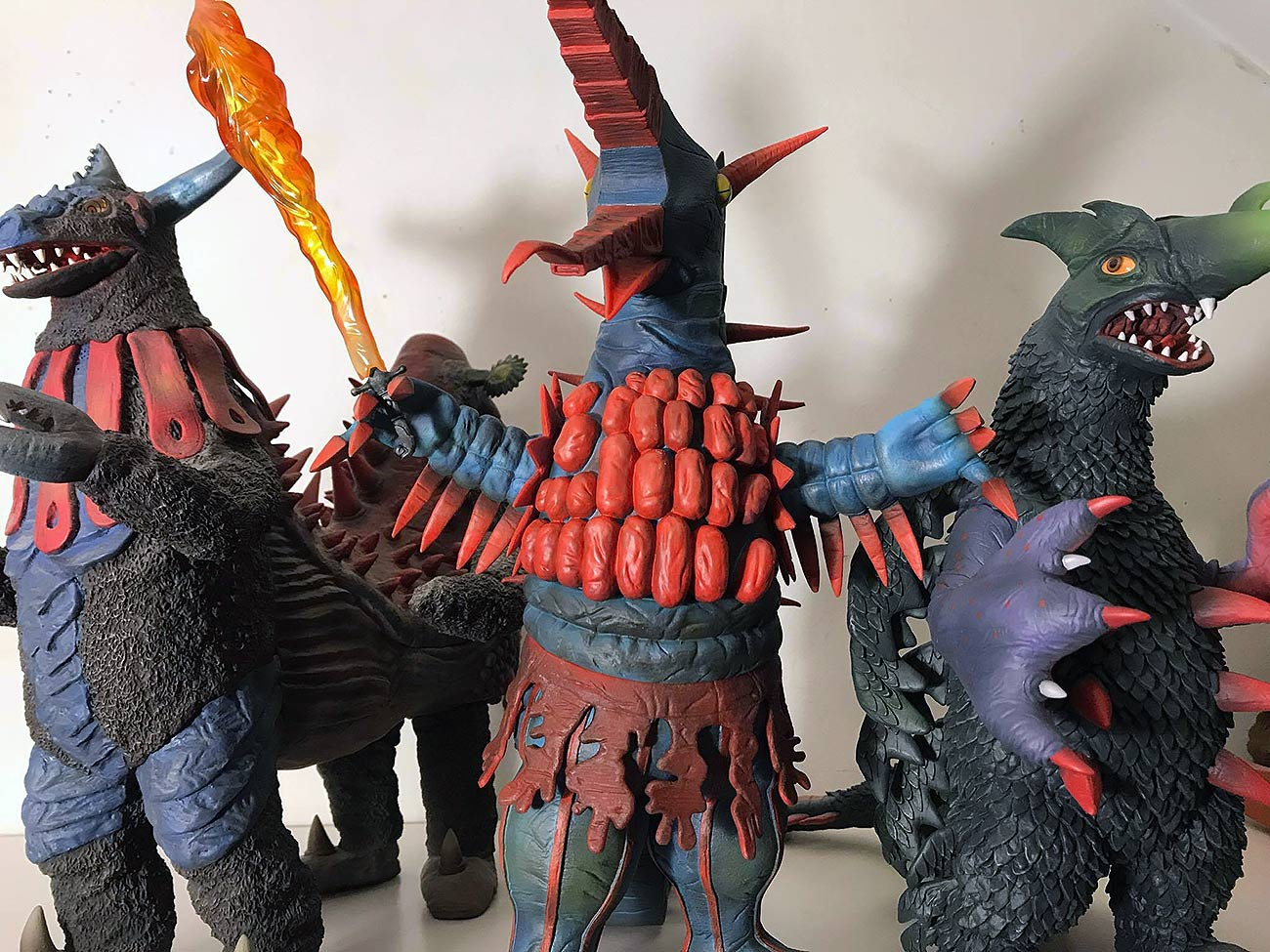 X-Plus Firemons vinyl figure among other Ultra kaiju vinyls by X-Plus. Photo by Vince Elliot.