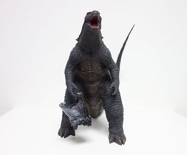 The X-Plus 30cm Series Godzilla 2014 Roar Version with MUTO head hanging from hand.