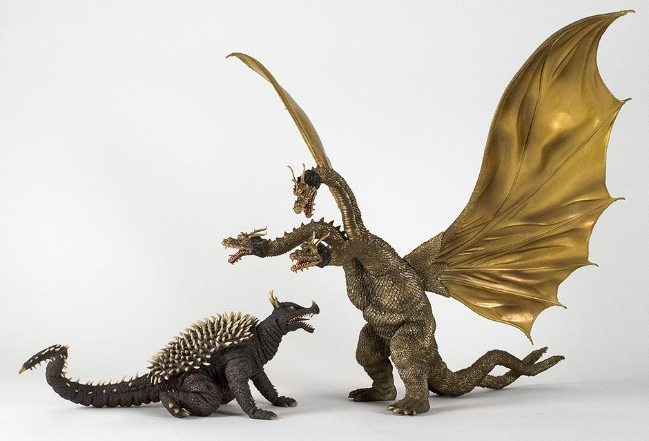 Size comparison between the Large Monster Series Aguirus 1968 and King Ghidorah 1968 vinyl figures by X-Plus.