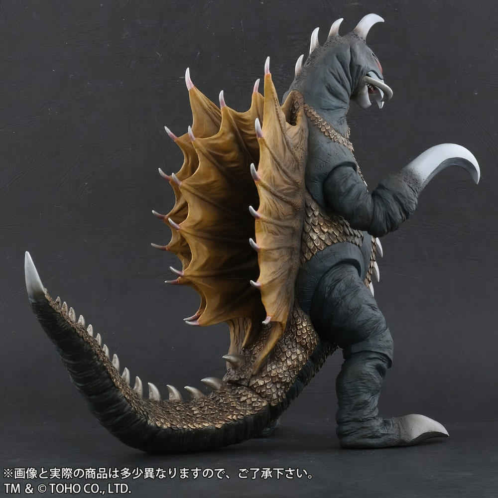 Rear right side of Toho Large Monster Series Gigan (1972) Nighttime Lightup Version vinyl figure by X-Plus.
