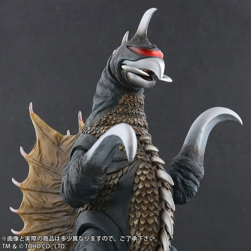 Closer front right view of Toho Large Monster Series Gigan (1972) Nighttime Lightup Version vinyl figure by X-Plus.