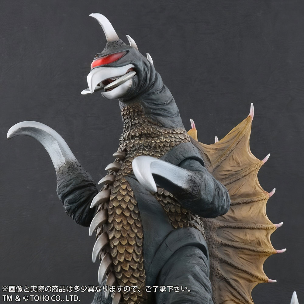 Closer front left view of Toho Large Monster Series Gigan (1972) Nighttime Lightup Version vinyl figure by X-Plus.