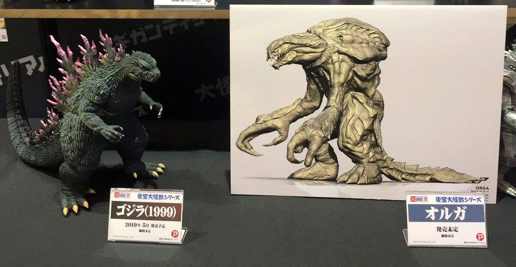 Painted prototype of the Large Monster Series Godzilla 1999 and image of digital sculpt of Orga by X-Plus on display at Wonder Festival.