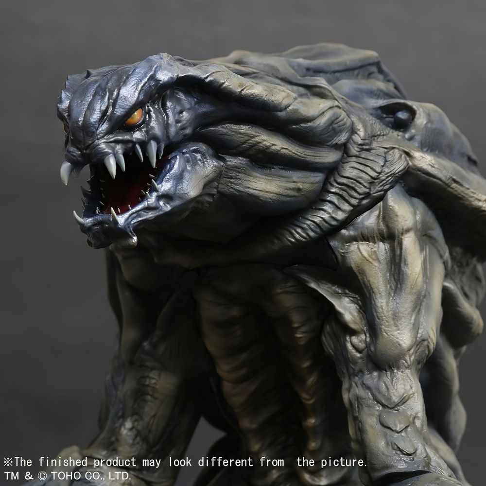 Left close-up view of the Large Monster Series Orga vinyl figure by X-Plus.