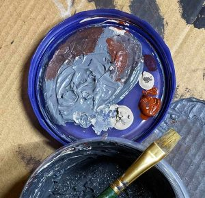 Paints being mixed to form the perfect Godzilla Gray.