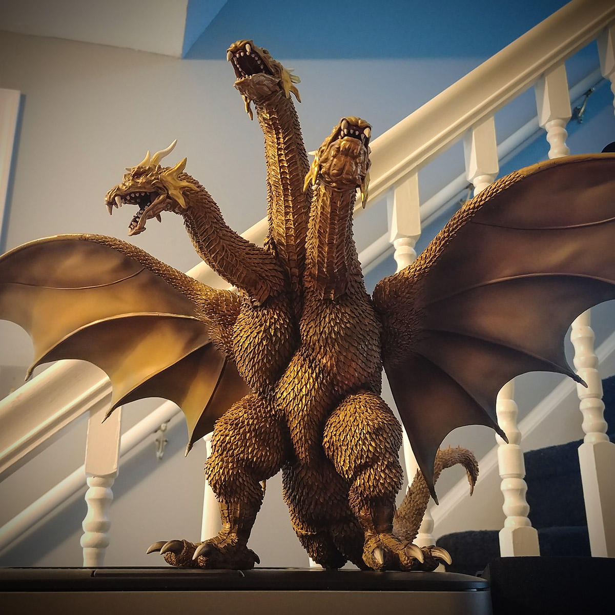 The X-Plus Large Monster Series King Ghidorah 2001 vinyl figure on my desk.